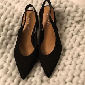 Black sling back pumps